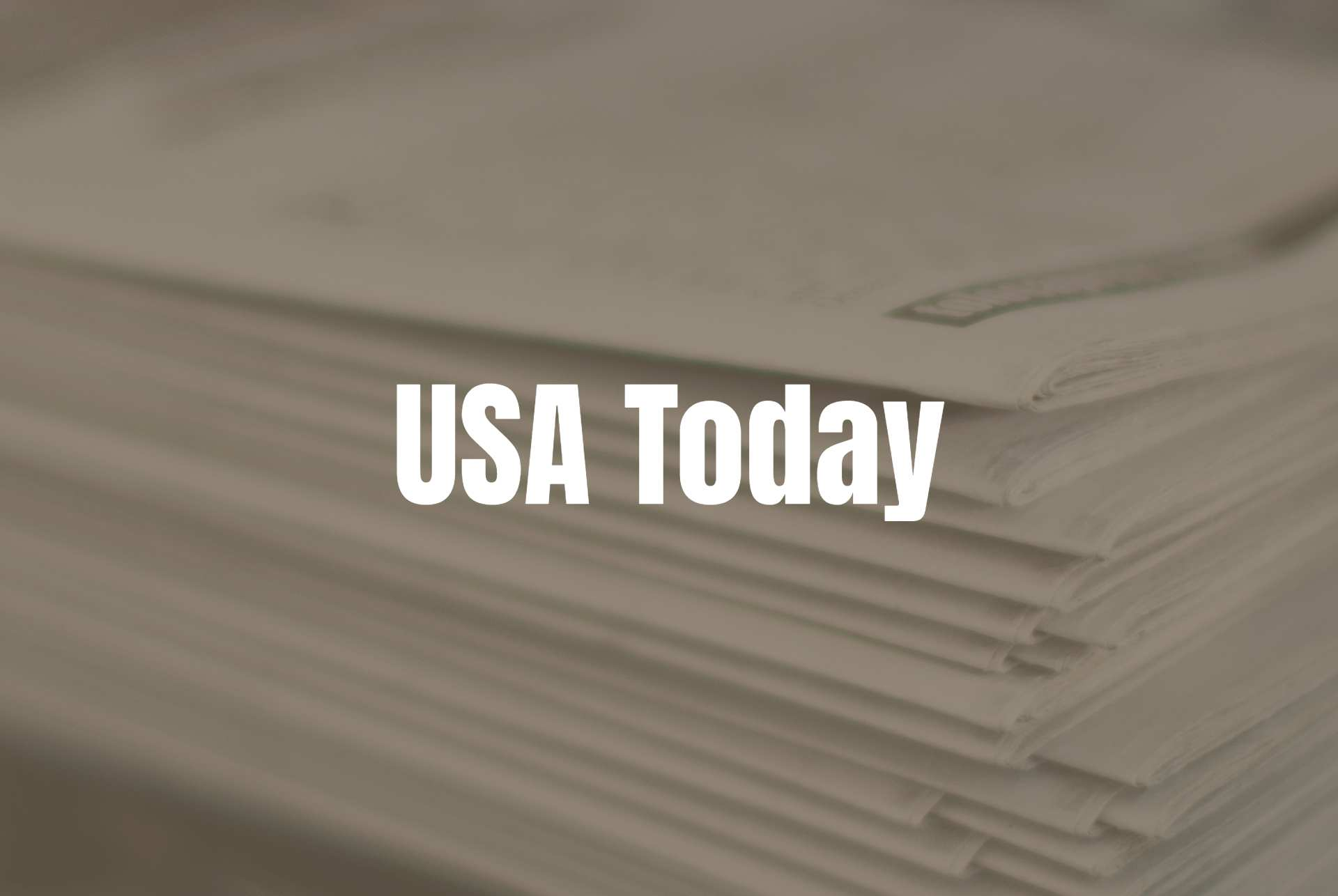 USA Today Cover Photo text on an old time newspaper stack background